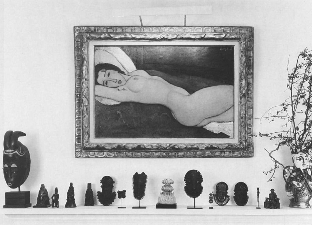 The dining room of the Perls home, with Benin art (and a Baule mask) displayed beneath Nu Couché by Amedeo Modigliani, 1918.