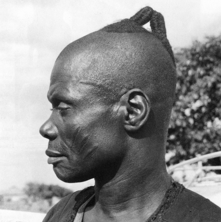 """Kings's messenger, """"are."""" Shaki. Portrait photographed by William Fagg in 1959."""