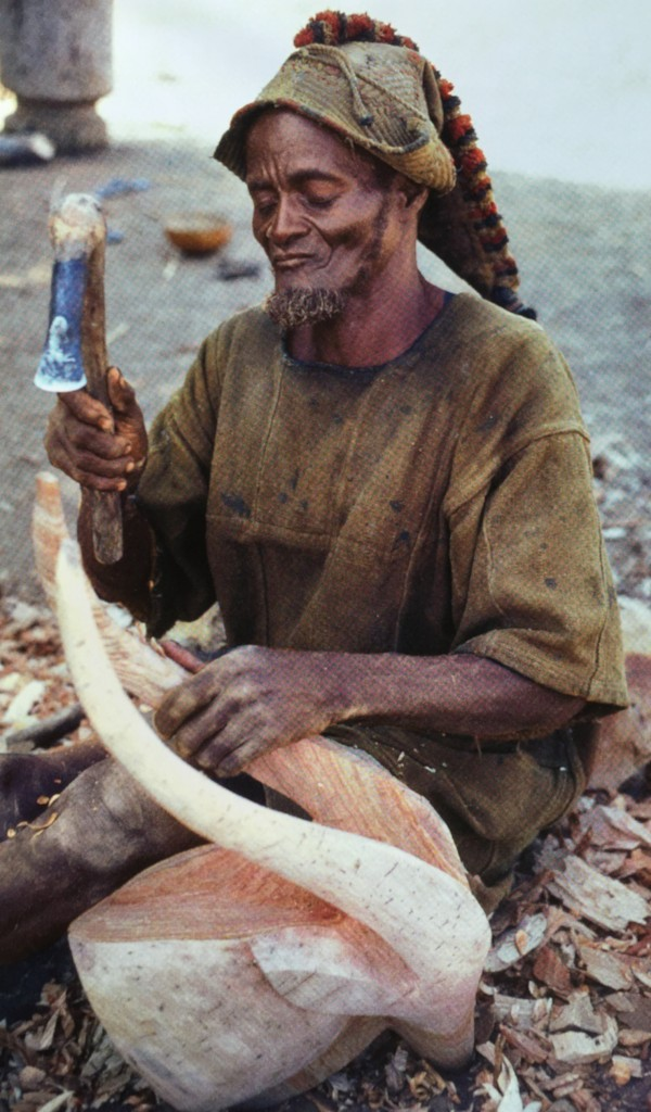 """The Mossi wood carver Roago Sawadogo, photographed in Sini in 1984. Published in Roy (C. D.) & Wheelock (T. G.B.), """"Land of the Flying Masks. Art and Culture in Burkina Faso. The Thomas G.B. Wheelock Collection"""", Munich, 2007: p. 41, fig. 10. Image courtesy of Thomas Wheelock."""