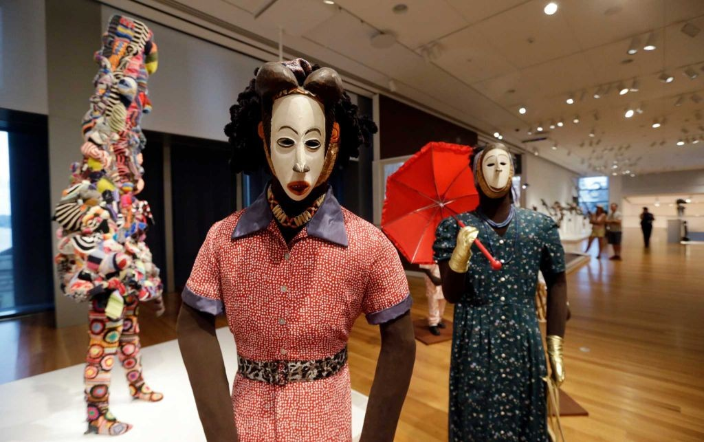 """Installation view """"Disguise: Masks & Global African Art"""" at the Seattle Art Museum. Image courtesy of Elaine Thompson, AP."""